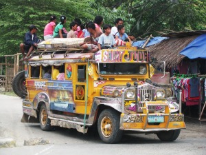 Jeepneys are converted bus/van vehcles used for public transportation.