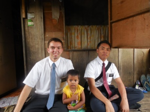 Cute Filipino child with Elder Burbidge and his companion.