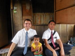 Cute Filipino child with Elder Burbidge and his companion.