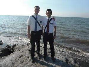 Elder Hunter Burbidge and Elder Doloritos near the sea shore.