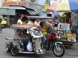 A motorcycle equipped with a sidecar is very typical transport around town.